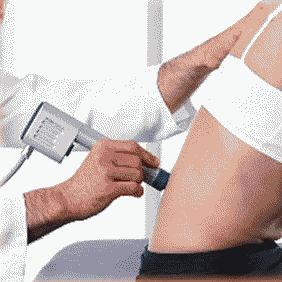 Treatment of pain in the back and waist by SWT